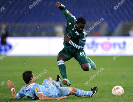 Ss Lazio's Lorik Cana (l) Vies For the Ball with Panathinaikos's Quincy Owusu-abeyie During Their Uefa Europa League Soccer Match at the Olimpico Stadium in Rome Italy 08 November 2012 Italy Roma