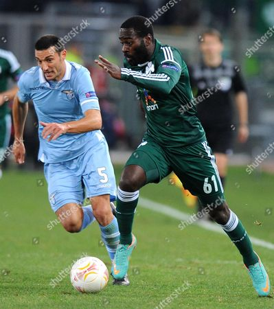 Stock Image of Ss Lazio's Lionel Scaloni (l) Vies For the Ball with Panathinaikos's Quincy Owusu-abeyie During Their Uefa Europa League Soccer Match at the Olimpico Stadium in Rome Italy 08 November 2012 Italy Roma