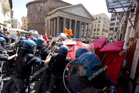 Policemen and Protesters Clash in Front of the Pantheon in Rome Italy 14 June 2012 Temporary Workers and Students who Called Themselves 'Occupy Fornero' (name of Minister of Welfare Elsa Fornero) Were Demonstrating Against the Severe Measures Taken by the Government Against the Crisis and Tried to Break Through the Police Setting Off Clashes Italy Rome