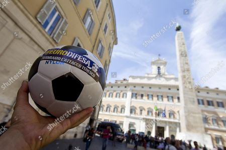 A Protester Shows a Ball with the Picture of Angela Merkel and a Small Sentence: 'Stop to German Attack' As Police and Protesters Clash in Front of the Pantheon in Rome Italy 14 June 2012 Temporary Workers and Students who Called Themselves 'Occupy Fornero' (name of Minister of Welfare Elsa Fornero) Were Demonstrating Against the Severe Measures Taken by the Government Against the Crisis and Tried to Break Through the Police Setting Off Clashes Italy Rome