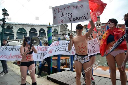 Italian Students Dressed in Underwear and Wearing Venetian Masks Protest in Front of the Rialto Bridge Against Government Cuts to Scholarships in Venice Italy 05 February 2013 a Placards Reads 'We Expose the Truth' and a Banner is Critical of Italy's Minister of Education Francesco Profumo Italy Venice