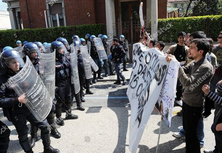 Protesters Face Riot Police During with Policemen in Front the 'New Theatre' in Turin 21 April 2012 the Students Are Protesting Against Italian Ministers Elsa Fornero Italian Minister of Welfare and Francesco Profumo Italy's Minister of Education As Well As Against Government Budget Cuts in Education University and Research Youth Unemployment in Italy Has Reached 31 9 Per Cent Italy Turin