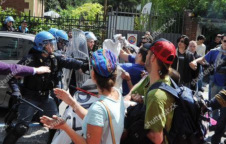 Protesters Face Riot Police During with Policemen in Front the 'New Theatre' in Turin Italy 21 April 2012 the Students Are Protesting Against Italian Ministers Elsa Fornero Italian Minister of Welfare and Francesco Profumo Italy's Minister of Education As Well As Against Government Austerity Measures on Education University and Research Youth Unemployment in Italy Has Reached 31 9 Per Cent Italy Turin