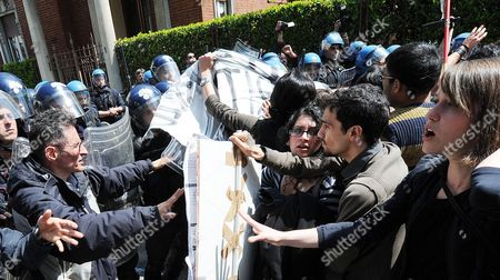 Protesters Face Riot Police During with Policemen in Front the 'New Theatre' in Turin Italy 21 April 2012 the Students Are Protesting Against Italian Ministers Elsa Fornero Italian Minister of Welfare and Francesco Profumo Italy's Minister of Education As Well As Against Government Budget Cuts in Education University and Research Youth Unemployment in Italy Has Reached 31 9 Per Cent Italy Turin