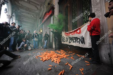 Stock Picture of Students Throw Carrots Against the Headquarters of the Ministry of Education in Turin Italy 12 October 2012 to Protest Against the Statement by the Minister Francesco Profumo who Recently Said That the Students Need the Carrot and the Stick High-school and University Students Took to the Streets of 90 Italian Cities to Protest Against Government Cuts to Education and Other Austerity Policies Italy Turin