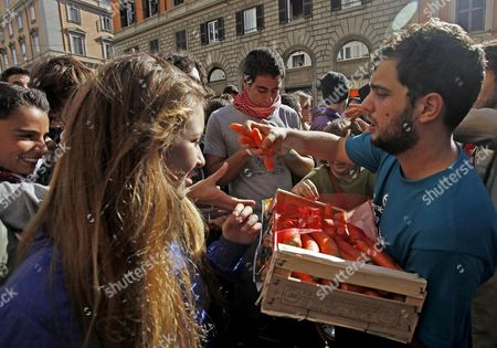 A Demonstrator Distributes Carrots During Students' Protest March in Rome Italy 12 October 2012 the Initiative is Against the Statement of Minister of Instruction Francesco Profumo who Recently Said That Students Need the Carrot and the Stick Italy Rome