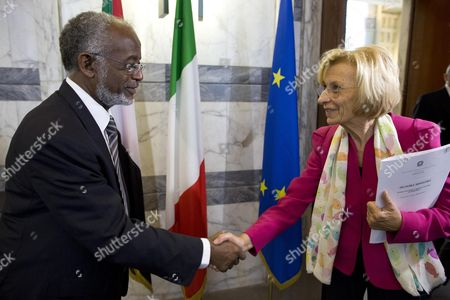Italian Foreign Ministry Emma Bonino (r) Shakes Hands with Sudanese Foreign Minister Ali Karti at Farnesina Rome Italy 03 October 2013 Ali Karti is on an Official Visit to Italy Italy Rome