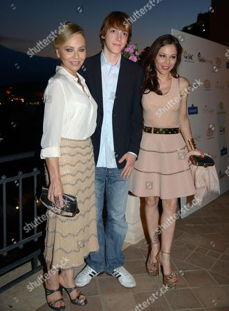Italian Actress Ornella Muti (l) Poses with Her Daughter Italian Actress Naike Rivelli (r) and Her Nephew During a Party Before the Special Evening Dedicated to the 'Fondation Prince Albert Ii of Monaco' where the Prince Worked For Many Years on the Protection of the Environment and Promotion of Sustainable Development on a Global Scale During the Taormina Film Festival at the Teatro Antico in Taormina Sicily Island Italy Late 16 June 2013 the 59th Edition of the Festival Runs From 15 Until 22 June Italy Taormina