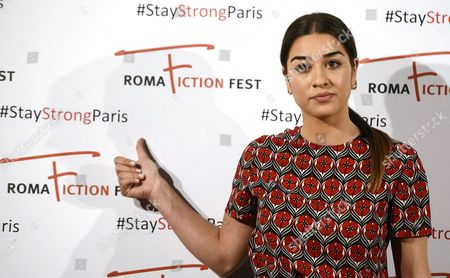 Italian Actress Simona Tabasco Points to a Hashtag Sign Reading '#stay Strong Paris' During a Photocall at the Roma Fiction Fest in Rome Italy 14 November 2015 at Least 120 People Have Been Killed in a Series of Attacks in Paris on 13 November According to French Officials Italy Rome