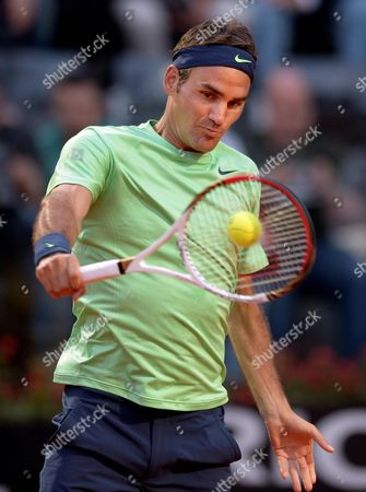 Swiss Tennis Player Roger Federer Returns the Ball to Italy's Potito Starace During Their Second Round Match of the Italian Open Tennis Tournament at Foro Italico in Rome Italy 14 May 2013 Italy Rome