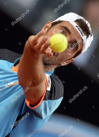 Stock Picture of Italy's Potito Starace Serves the Ball to Swiss Player Roger Federer During Their Second Round Match of the Italian Open Tennis Tournament at Foro Italico in Rome Italy 14 May 2013 Italy Rome