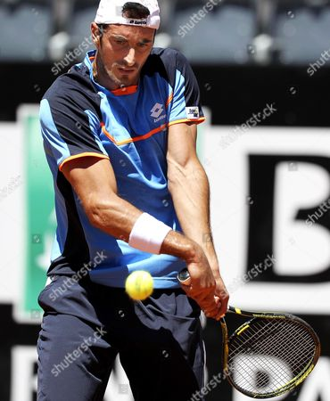 Italian Tennis Player Potito Starace Returns the Ball to Czech Republic's Radek Stepanek During Their First Round Match of the Italian Open Tennis Tournament at Foro Italico in Rome Italy 13 May 2013 Italy Rome