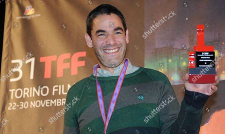 Mexican Film Director Fernando Eimbcke Poses with His Award For the Film 'Club Sandwich' During the Awards Ceremony of the 31st Torino Film Festival in Turin Italy 30 November 2013 Italy Torino