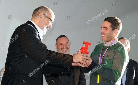 Stock Picture of Mexican Film Director Fernando Eimbcke (r) Receives From Director of the Jury Guillermo Arriaga an Award For the Film 'Club Sandwich' During the Awards Ceremony of the 31st Torino Film Festival in Turin Italy 30 November 2013 Italy Torino