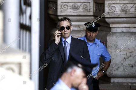 Niccolo Ghedini the Lawyer of Former Italian Prime Minister Silvio Berlusconi Uses His Mobile at the Entrance of the Court of Cassation Building During a Pause of the Supreme Court Session Which Will Decide Whether to Confirm Former Italian Prime Minister Silvio Berlusconi's One-year Prison Sentence and Five-year Ban From Politics in a Long-running Tax Fraud Case Involving His Media Business Interests in Central Rome 30 July 2013 the Court Decision was Unlikely 30 July on Former Italian Premier Silvio Berlusconi's Final Appeal of His Tax Fraud Conviction Italian Media Reported the Court of Cassation Which was Hearing the Appeal Could Make Its Decision 31 July Or 01 August Given the Complex Procedures Involved the Reports Said Italy Rome