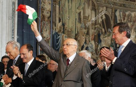 Italian President Giorgio Napolitano (c) Flutters a Small Italian Flag As He Waves to People with Chambers President Gianfranco Fini (r) and Senate President Renato Schifani (2-l) Accompanying Him During a Ceremony Marking This Year's 150th Anniversary of Italy Unity in Rome Italy 17 March 2012 Italy Rome