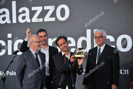 Stock Photo of (l-r) Venice Mayor Giorgio Orsoni Venice Art Biennale Curator Massimiliano Gioni British-german Artist Tino Sehgal and Biennale President Paolo Baratta Pose During the Award Ceremony at the 55th International Art Exhibition Garden in Venice Italy 01 June 2013 Sehgal Won the Golden Lion For Best Artist the Art Biennale of Venice Opens to the Public From 01 June to 24 November Italy Venice