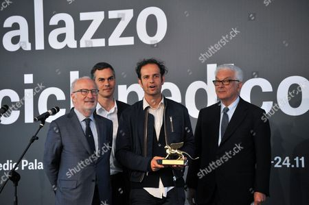 (l-r) Venice Mayor Giorgio Orsoni Venice Art Biennale Curator Massimiliano Gioni British-german Artist Tino Sehgal and Biennale President Paolo Baratta Pose During the Award Ceremony at the 55th International Art Exhibition Garden in Venice Italy 01 June 2013 Sehgal Won the Golden Lion For Best Artist the Art Biennale of Venice Opens to the Public From 01 June to 24 November Italy Venice