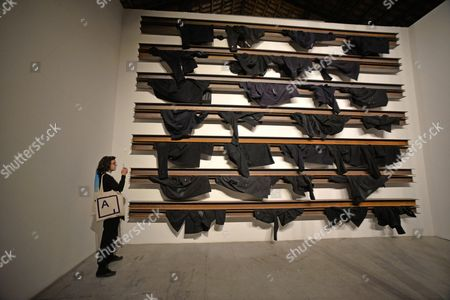 A Woman Stands Next to the Artwork by Greek Artist Jannis Kounellis Displayed in the Italy Pavillion at the 56th International Art Exhibition in Venice Italy 07 May 2015 the Venice Biennale Entitled 'All the World's Futures' Runs 09 May to 22 November Italy Venice