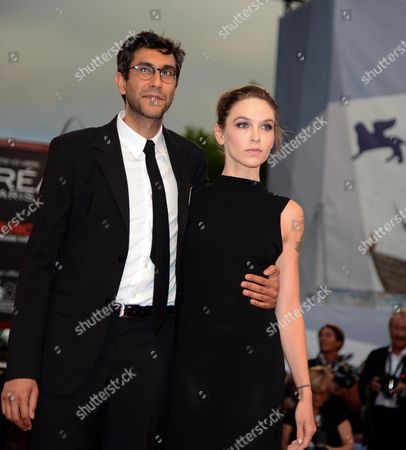 Stock Image of Us Writer Hallie Elizabeth Newton (r) and Us Director Ramin Bahrani Arrive For the Premiere of 'At Any Price' During the 69th Venice International Film Festival in Venice Italy 31 August 2012 the Movie is Presented in the Official Competition 'Venezia 69' of the Festival Which Runs From 29 August to 08 September Italy Venice