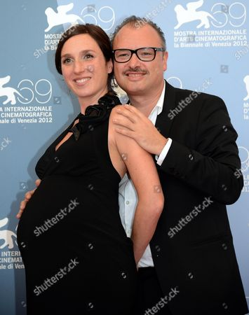Actress Anne Paulicevich (l) and Belgian Director Frederic Fonteyne (r) Pose at a Photocall For the Movie 'Tango Libre' During the 69th Venice International Film Festival in Venice Italy 30 August 2012 the Movie is Presented in the Orizzonti Competition at the Festival Which Runs From 29 August to 08 September Italy Venice