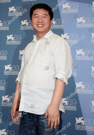 Chinese Director Wang Bing Poses at a Photocall For 'San Zimei (three Sisters) at the 69th Venice Film Festival in Venice Italy 07 September 2012 the Movie is Presented in the Orizzonti Section of the Festival Which Runs From 29 August to 08 September Italy Venice