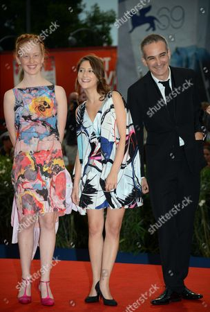 French Director Olivier Assayas (r) with French Actresses/cast Members Lola Cetron (c) and India Salvor Menuez (l) As They Arrive For the Premiere of Their Movie 'Apres Mai (something in the Air)' During the 69th Venice International Film Festival in Venice Italy 03 September 2012 the Movie is Presented in the Official Competition of the Festival Which Runs From 29 August to 08 September Italy Venice