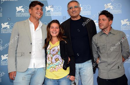 Stock Photo of Italian Director Leonardo Di Costanzo (2-r) Poses with Italian Actors Alessio Gallo (l) Francesca Riso (2-l) and Carmine Patermoster (r) at a Photocall For 'L'intervallo' During the 69th Venice International Film Festival in Venice Italy 04 September 2012 the Movie is Presented in the Orizzonti Section of the Festival Which Runs From 29 August to 08 September Italy Venice