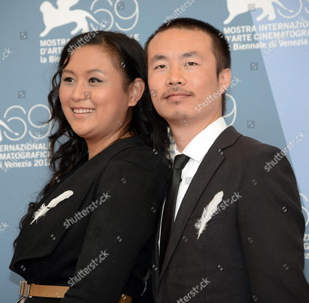 Chinese Director Li Ruijun (r) and Chinese Actress Zhang Min Pose at a Photocall For 'Gaosu Tamen Wo Cheng Baihe Qu Le (fly with the Crane)' During the 69th Venice International Film Festival in Venice Italy 05 September 2012 the Movie is Presented in the Orizzonti Section of the Festival Which Runs From 29 August to 08 September Italy Venice
