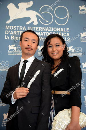 Chinese Director Li Ruijun (l) and Chinese Actress Zhang Min Pose at a Photocall For 'Gaosu Tamen Wo Cheng Baihe Qu Le (fly with the Crane)' During the 69th Venice International Film Festival in Venice Italy 05 September 2012 the Movie is Presented in the Orizzonti Section of the Festival Which Runs From 29 August to 08 September Italy Venice