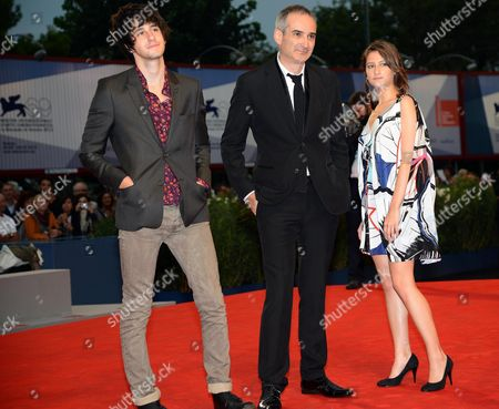 French Director Olivier Assayas (c) Poses with French Actors Lola Creton (r) and Clement Metayer (l) As They Arrive For the Premiere of Their Movie 'Apres Mai (something in the Air)' During the 69th Venice International Film Festival in Venice Italy 03 September 2012 the Movie is Presented in the Official Competition of the Festival Which Runs From 29 August to 08 September Italy Venice
