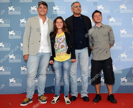 Stock Image of Italian Director Leonardo Di Costanzo (2-r) Poses with Italian Actors Alessio Gallo (l) Francesca Riso (2-l) and Carmine Patermoster (r) at a Photocall For 'L'intervallo' During the 69th Venice International Film Festival in Venice Italy 04 September 2012 the Movie is Presented in the Orizzonti Section of the Festival Which Runs From 29 August to 08 September Italy Venice