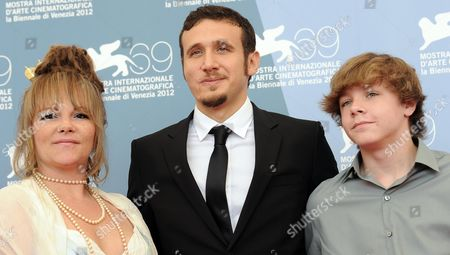 Stock Picture of (l-r) Actress Melissa Mckinney Film Director Roberto Minervini and Actor Daniel Blanchard Pose During the Photocall For 'Low Tide' During the 69th Venice International Film Festival in Venice Italy 02 September 2012 the Movie is Presented in the Orizzonti Section During the Festival Which Runs From 29 August to 08 September Italy Venice