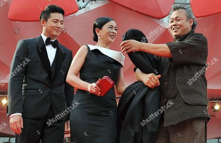 Director Kim Ki-duk (r) and Actors Cho Min-soo (c) and Lee Jung-jin Arrive For the Premiere of Their Movie 'Pieta' During the 69th Venice International Film Festival in Venice Italy 04 September 2012 the Movie is Presented in the Official Competition of the Festival Which Runs From 29 August to 08 September Italy Venice