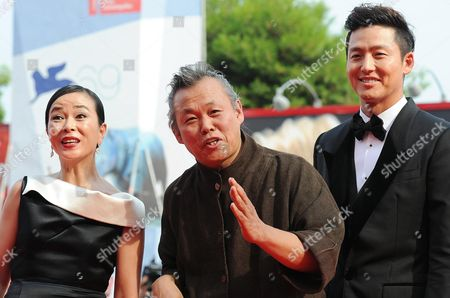 Director Kim Ki-duk (c) and Actors Cho Min-soo (l) and Lee Jung-jin Arrive For the Premiere of Their Movie 'Pieta' During the 69th Venice International Film Festival in Venice Italy 04 September 2012 the Movie is Presented in the Official Competition of the Festival Which Runs From 29 August to 08 September Italy Venice