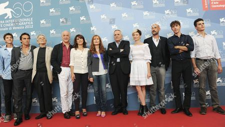 Stock Photo of (l-r) Italian Actors Fabrizio Falco Pier Giorgio Bellocchio Roberto Herlitzka Tony Servillo and Maya Sansa French Actress Isabelle Huppert Italian Director Marco Bellocchio (l) and Italian Actors Alba Rohrwacher Gian Marco Tognazzi Michele Riondino and Brenno Placido Pose at a Photocall For 'Bella Addormentata' During the 69th Venice International Film Festival in Venice Italy 05 September 2012 the Movie is Presented in the Official Competition of the Festival Which Runs From 29 August to 08 September Italy Venice