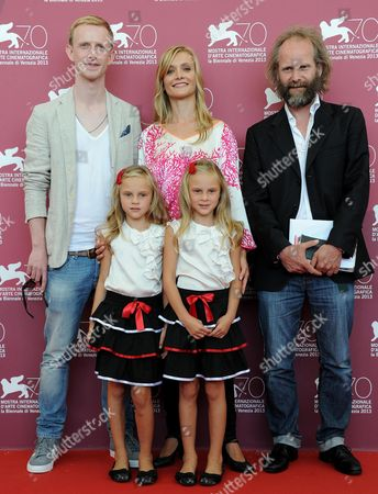 (back L-r) German Actors David Zimmerschied and Alexandra Finder Film Director Philip Groning and (front Row) Actresses Pia and Chiara Kleeman Pose During a Photocall For the Movie 'Die Frau Des Polizisten (the Police Officer's Wife)' During the 70th Annual Venice International Film Festival in Venice Italy 30 August 2013 the Movie is Presented in Official Competition at the Festival That Runs From 28 August to 07 September Italy Venice