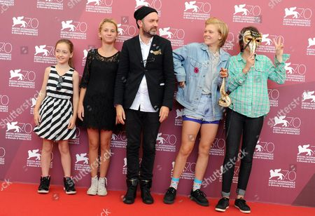 Stock Image of (l-r) Director's Daugther Lily Moodysson Actress Mira Barkhammar Swedish Director Lukas Moodysson Actresses Liv Lemoyne and Mira Grosin Pose at a Photocall For 'Vi Ar Bast!' (we Are the Best!) During the 70th Annual Venice International Film Festival in Venice Italy 31 August 2013 the Movie is Presented in the Orizzonti Section of the Festival That Runs From 28 August to 07 September Italy Venice