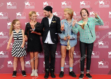 Stock Photo of (l-r) Director's Daugther Lily Moodysson Actress Mira Barkhammar Swedish Director Lukas Moodysson Actresses Liv Lemoyne and Mira Grosin Pose at a Photocall For 'Vi Ar Bast!' (we Are the Best!) During the 70th Annual Venice International Film Festival in Venice Italy 31 August 2013 the Movie is Presented in the Orizzonti Section of the Festival That Runs From 28 August to 07 September Italy Venice
