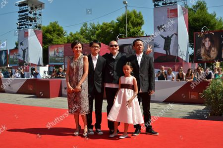 (l-r) Taiwan Actors Lu Yi-ching Lee Yi-cheng Taiwan Director Tsai Ming-liang Taiwan Actors Lee Kang-sheng and Lee Yi-chieh Arrive For the Premiere of 'Jiaoyou' (stray Dogs) at the 70th Annual Venice International Film Festival in Venice Italy 05 September 2013 the Movie is Presented in the Official Competition Venezia 70 of the Festival That Runs From 28 August to 07 September Italy Venice