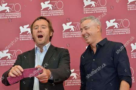 French Actor Olivier Rabourdin (l) and French Director Robin Campillo Look at a Cellphone During a Photocall For 'Eastern Boys' at the 70th Annual Venice International Film Festival in Venice Italy 04 September 2013 the Movie in the Orizzonti Section of the Festival Running From 28 August to 07 September Italy Venice