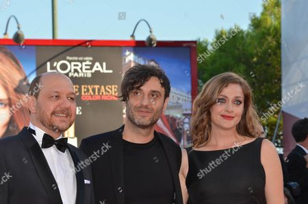 From L-r Greek Actor Themis Panou Greek Director Alexandros Avranas and Greek Actress Eleni Rossinou Pose For Photos During Red Carpet Arrivals to Attend the Awarding Ceremony of the Venice International Film Festival 07 September 2013 Italy Venice