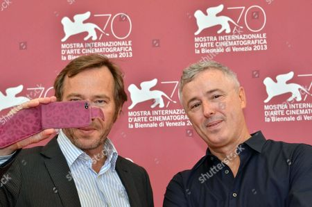 French Actor Olivier Rabourdin (l) and French Director Robin Campillo Pose During a Photocall For 'Eastern Boys' at the 70th Annual Venice International Film Festival in Venice Italy 04 September 2013 the Movie in the Orizzonti Section of the Festival Running From 28 August to 07 September Italy Venice