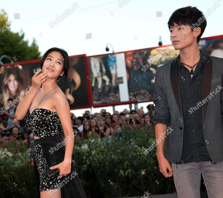 (l-r) South Korean Actors/cast Members Lee Eun-woo and Seo Young-joo Arrive on the Red Carpet to Promote the Movie 'Moebius' at the 70th Annual Venice International Film Festival in Venice Italy 03 September 2013 the Movie is Presented out of Competition the Festival Runs From 28 August to 07 September Italy Venice