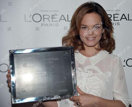Stock Photo of Italian Actress Eugenia Costantini Poses with Her L'oreal Paris Award For Cinema 2013 During the 70th Annual Venice International Film Festival in Venice Italy 06 September 2013 the Festival Runs From 28 August to 07 September Italy Venice