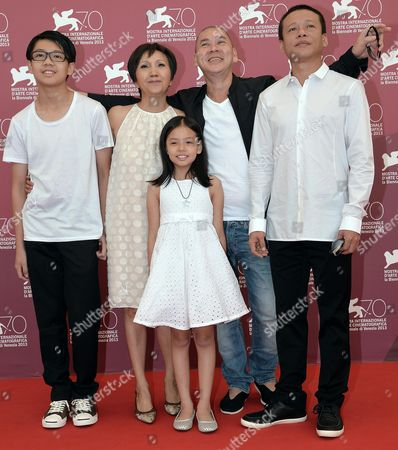 (l-r) Taiwan Actors/cast Members Lee Yi-cheng Lu Yi-ching Taiwan Director Tsai Ming-liang Lee Kang Sheng and Lee Yi-chieh (front) Pose at the 70th Annual Venice International Film Festival in Venice Italy 05 September 2013 the Movie is Presented in the Official Competition Venezia 70 the Festival Runs From 28 August to 07 September Italy Venice