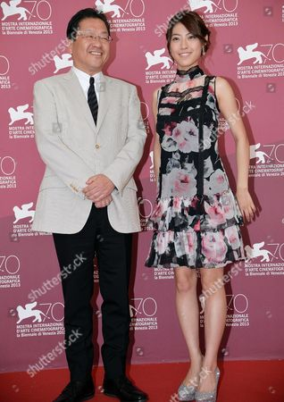 Japanese Actress Miori Takimoto (r) and Producer Koji Hoshino (l) Pose at a Photocall For 'Kaze Tachinu' (the Wind Rises) During the 70th Annual Venice International Film Festival in Venice Italy 01 September 2013 the Movie is Presented in the Official Competition Venezia 70 of the Festival Running From 28 August to 07 September Italy Venice