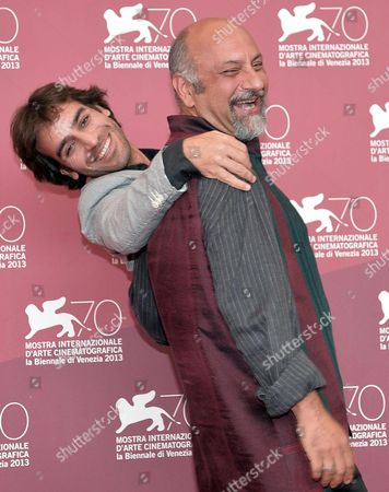 Iranian Writer and Director Shahram Mokri (l) and Actor Babak Karimi Pose at a Photocall For 'Mahi Va Gorbeh' (fish & Cat) During the 70th Annual Venice International Film Festival in Venice Italy 06 September 2013 the Movie is Presented in the Orizzonti Section at the Festival That Runs From 28 August to 07 September Italy Venice