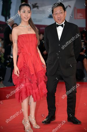 Stock Picture of Japanese Actress Miori Takimoto (l) and Producer Koji Hoshino (r) Arrive For the Screening of 'Kaze Tachinu' (the Wind Rises) During the 70th Annual Venice International Film Festival in Venice Italy 01 September 2013 the Movie is Presented in the Official Competition Venezia 70 of the Festival Running From 28 August to 07 September Italy Venice