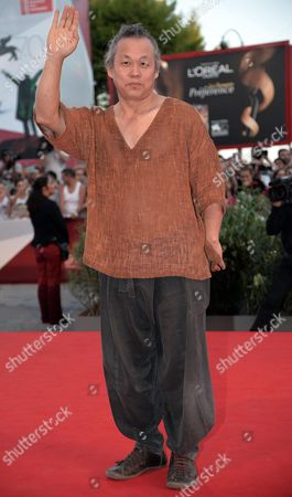 South Korean Film Director Kim Ki-duk Arrives on the Red Carpet to Promote the Movie 'Moebius' at the 70th Annual Venice International Film Festival in Venice Italy 03 September 2013 the Movie is Presented out of Competition the Festival Runs From 28 August to 07 September Italy Venice